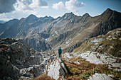 Female mountaineer in front of Swiss mountain massif, Switzerland, mountains, mountaineering,