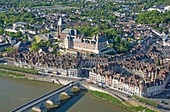 France, Loiret, Gien, Sainte Jeanne d'Arc (Joan of Arc) church, the castle and the banks of the Loire river (aerial view)