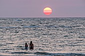 France, Charente Maritime, Oleron island, young women on the beach at sunset