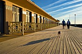France, Calvados, Pays d'Auge, Deauville, the famous planks on the beach, lined with Art Deco style bathing cabins, each with the name of a celebrity who participated in the Deauville American Film Festival