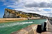 France, Seine Maritime, Pays de Caux, Cote d'Albatre, Fecamp, wooden footbridge at the entrance of the harbour and the Cap Fagnet in the background
