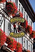 France, Haut Rhin, Eguisheim, wrought iron signs on facades