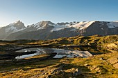 France, Hautes Alpes, the Grave, on the plateau of Emparis the Black Lake facing the massif of Meije at sunrise