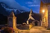 France, Hautes Alpes, The massive Grave of Oisans, dusk on the church facing the Meije