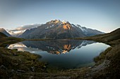 France, Hautes Alpes, The massive Grave of Oisans, Lake Pontet mirror of the Meije at sunrise