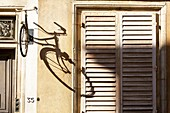 France, Meurthe et Moselle, Nancy, shadow of a bicycle on a facade