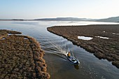 France, Aude, Gruissan, Saint-Martin Island, Ayrolle, Denis Bès, fisherman, passage between the pond of Campignol, in the background and the Ayrolle, aerial view