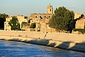 France, Bouches du Rhone, Arles, dock Max Dormoy, The Rhone and the Saint Julien church in the background