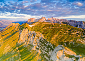 Clouds at dawn over the majestic Santis and Saxer Lucke mountains, aerial view, Appenzell Canton, Alpstein Range, Switzerland, Europe