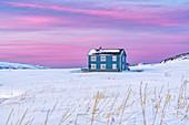 Isolated house in the snow under the pink arctic sunset, Veines, Kongsfjord, Varanger Peninsula, Troms og Finnmark, Norway, Scandinavia, Europe