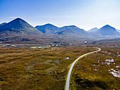 Road leading into the Black Cuillin ridge, Isle of Skye, Inner Hebrides, Scotland, United Kingdom, Europe