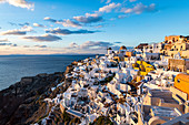 Whitewashed architecture at sunset, Oia, Santorini, Cyclades, Greek Islands, Greece, Europe