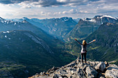 Woman standing on Dalsnibba View point, Geirangerfjord, UNESCO World Heritage Site, Sunnmore, Norway, Scandinavia, Europe