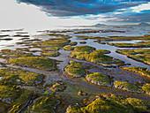 Aerial of the rugged coastline of the UNESCO World Heritage Site at sunset, the Vega Archipelago, Norway, Scandinavia, Europe