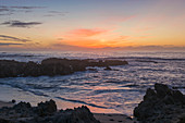 View across the Pacific Ocean from rocky coastline of the Monterey Peninsula, sunset, Pacific Grove, Monterey, California, United States of America, North America