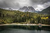 Boathouse on Blindsee with Zugspitze massif, Biberwier, Tyrol, Austria