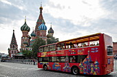 Hop On Hop Off Moscow City Sightseeing Bus in front of St. Basil's Cathedral on Red Square, Moscow, Russia, Europe