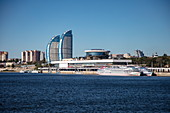 River cruise ships at the terminal and high-rise buildings with modern architecture seen from Volga River, Volgograd, Volgograd District, Russia, Europe