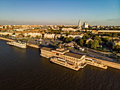 Aerial view of tour boats and floating restaurant along promenade on the bank of Volga river with Astrakhan Kremlin behind, Astrakhan, Astrakhan District, Russia, Europe