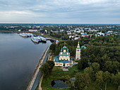 Aerial view of Russian Orthodox Church and river cruise ships docked along Volga River, Uglich, Yaroslavl, Russia, Europe