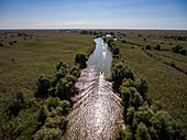 Aerial view of motorboat excursion to wetlands in the Volga Delta, near Karalat, Ostrakhan District, Russia, Europe