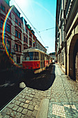 View of tram driving on street in Prague city