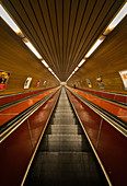 Low angle view of escalators in underground station in Prague city