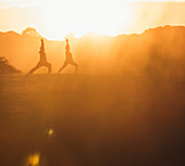Two women doing yoga on the beach in the morning light, yoga, beach, Portugal