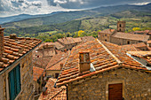 View over the roofs of Castel del Piano to the adjacent hills, Tuscany, Italy, Europe
