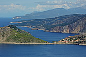View over the rugged west coast to the north, in the foreground the town of Assos with its castle, Kefalonia Island, Ionian Islands, Greece