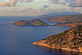 View over the rugged west coast to the north, in the center of the picture the town of Assos with its castle, island of Kefalonia, Ionian Islands, Greece