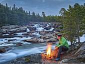Man at the campfire, Saltelva River, Saltfjellet-Svartisen, Nordland, Norway