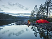 Red tent, man, campfire, Sefrivatnet, Tosfjellet, Nordland, Norway