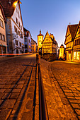 """Famous fork """"Plönlein"""" at the blue hour with light streaks from car in Rothenburg ob der Tauber, Middle Franconia, Bavaria, Germany"""