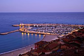 France, Alpes Maritimes, Menton, the old port, full moon evening in the spring