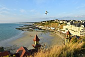 France, Manche, Cotentin, Granville, the Upper Town built on a rocky headland on the far eastern point of the Mont Saint Michel Bay, Plat Gousset beach and promenade, the casino towers in the foreground