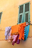 France, Alpes Maritimes, Nice, Old Nice district, dry clothes on a drying rack over the street