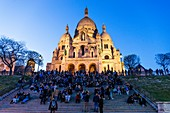France, Paris, Montmartre hill, Sacre Coeur Basilica at nightfall