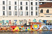 France, Rhone, Lyon, Quai du Maréchal Joffre, mytoc.fr barge, a 38-meter work of art, is a cultural platform moored on the banks of the Saone river