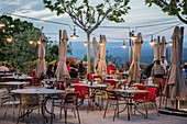 France, Vaucluse, regional natural park of Luberon, Ménerbes, labeled the Most Beautiful Villages of France, terrace of the Bistro 5