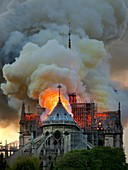 France, Paris, area listed as World Heritage by UNESCO, Notre Dame Cathedral of 14th century Gothic architecture during the fire of 15th April 2019, an overview of the incandescent carpentry