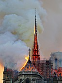 France, Paris, area listed as World Heritage by UNESCO, Notre Dame Cathedral of 14th century Gothic architecture during the fire of 15th April 2019, close-up on the incandescent frame