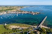 France, Manche, Cotentin, Barfleur, labeled Les Plus Beaux Villages de France (The Most Beautiful Villages of France), Harbour and Saint Nicolas church built from 17th century to 19th century (aerial view)