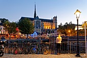 France, Somme, Amiens, Saint-Leu district, Quai Belu on the banks of the Somme river and Notre-Dame cathedral, jewel of the Gothic art, listed as World Heritage by UNESCO