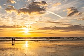 France, Somme, Ault, holidaymakers and anglers in Ault on the beach, in the evening, many walkers come to admire the sunset on the sea