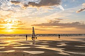 France, Somme (80), Ault, The large sandy beaches of the windswept coast of Picardy are an ideal place for the practice of the sail-hauler, at sunset