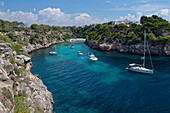 Yachts moored in the cove at Cala Pi, viewed from narrow cliff top coast path, South coast of Mallorca, Balearic Islands, Spain, Mediterranean, Europe