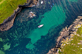 Aerial view of a yacht moored in Port Quin, Cornwall, England, United Kingdom, Europe