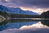 Sunrise over the mountains of the Rockies, reflected in Johnson Lake, Banff National Park, UNESCO World Heritage Site, Alberta, Canada, North America
