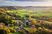 View in autumn over the village of Corton Denham and countryside at sunset, Corton Denham, Somerset, England, United Kingdom, Europe